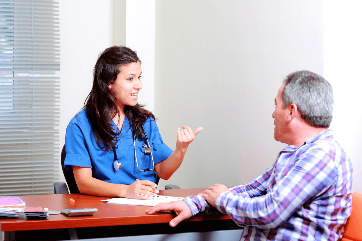 female nurse talking to a male patient