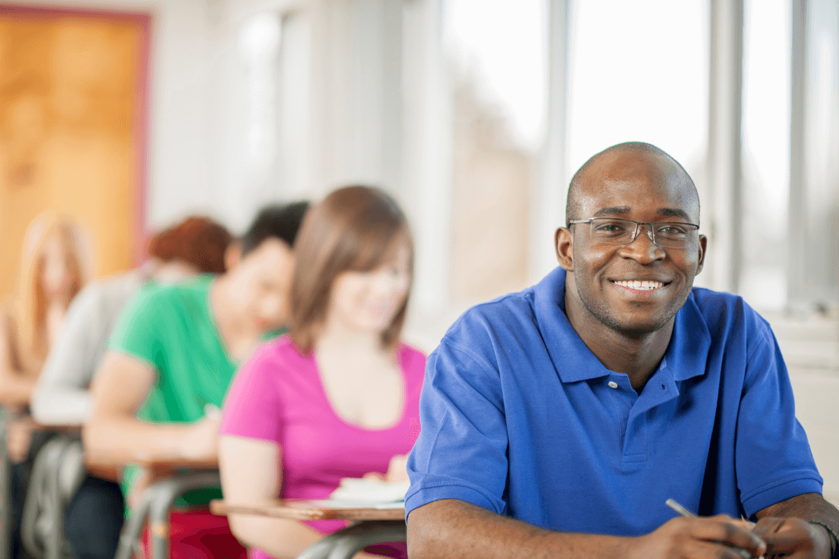 diverse students sitting at desks in a classroom