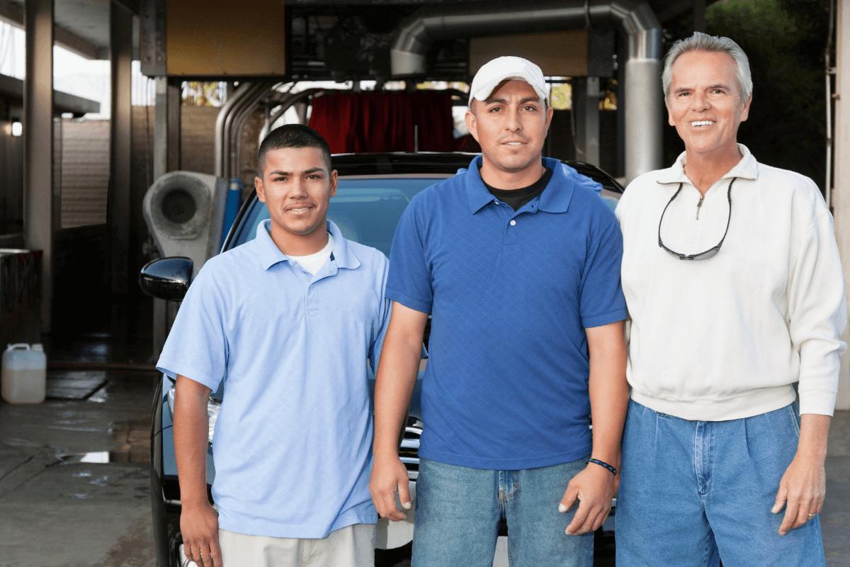 three young men standing shoulder to shoulder
