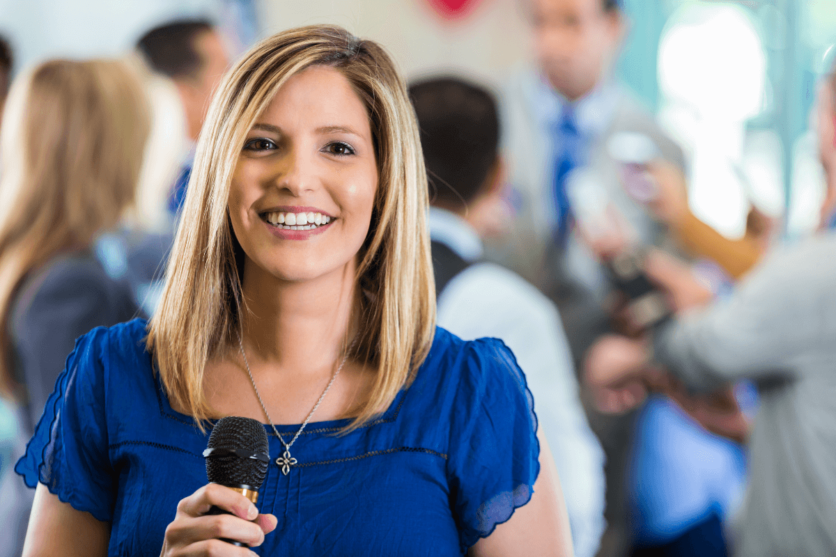 young woman holding a microphone