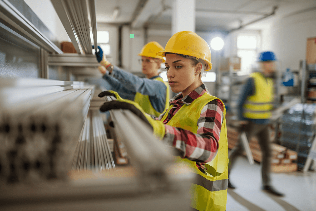 workers wearing hard hats in a warehouse