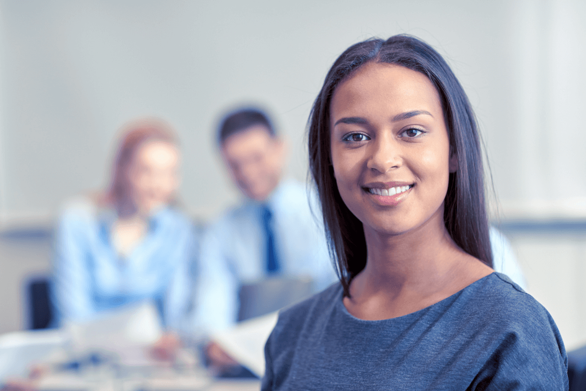 close up of a young woman in a conference room