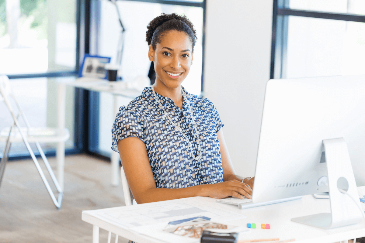 young African American woman sitting at a computer desk